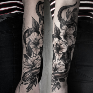 Black & grey snake & flowers tattoo by Izabela Emert done at Studio Malm