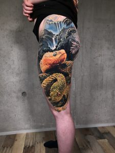Realistic snake tattoo by color realism tattoo artist Torsten Malm