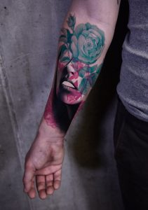 Abstract realism woman tattoo by Timur Lysenko done at Studio Malm