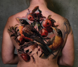 Realistic bird cover up by color realism tattoo artist Torsten Malm