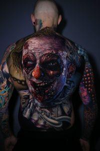 Realistic horror clown back tattoo by Torsten Malm, Kätlin Malm, Moriel Seror and Adrian Ciercoles. Done in Munich, Germany at Mori Occultum.